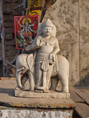 street creed: carred effigy of hindu gods at side of street