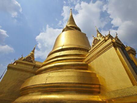 beautiful golden stupa of grand palace in cloudy day