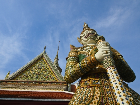 thai giant stand in front of temple