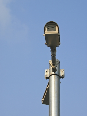 cctv camera fix on top of pole in sunlight photo