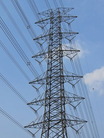 perspective of high voltage tower in sunny day