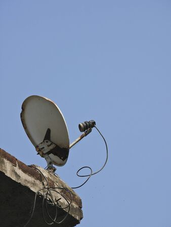 crush Satellite dish on top in sunny day photo