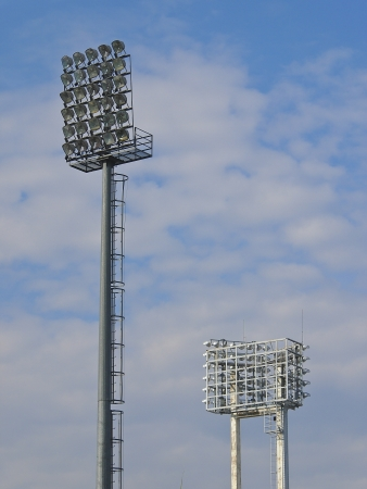 pair of football stadium floodlight in cloudy day photo