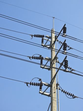 voltage gray: low voltage electricity post and cable in sunny day
