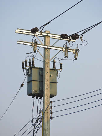 low voltage electricity post and Transformers in daytime Stock Photo