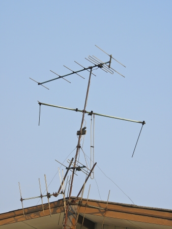 gable house: television antenna on gable house in sunlight
