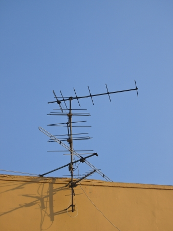 receive antenna on top roof in  sunny day Stock Photo