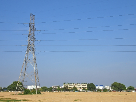 big high voltage tower in suburb area