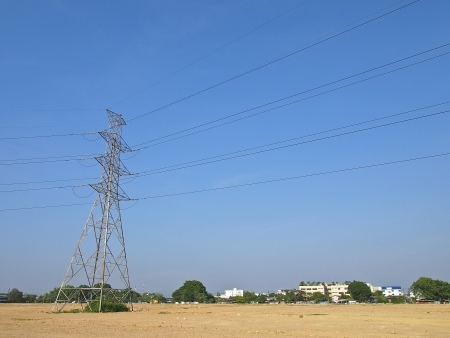 high voltage tower in empty land and blue sky photo