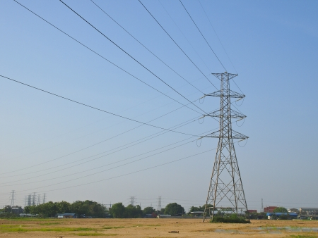 high voltage tower and grid line in plain terrain