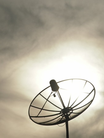 silhouette image of satellite dish in cloudy day photo
