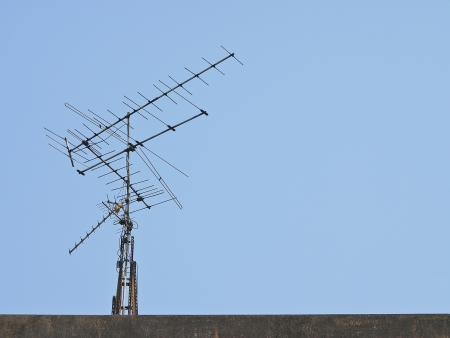 high frequency: old receiver tv antenna on top of building
