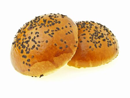 pile of pair red bean black sesame filled bun on white background