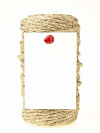 white paper note pin on hemp rope roll