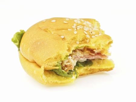 delicious bite of bolona burger bun on white background photo
