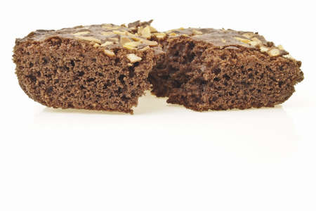 split piece of almonds brownies cake with copy area on white background photo