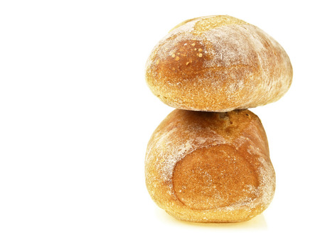 stack of two mini french baguette bread on white background Stock Photo