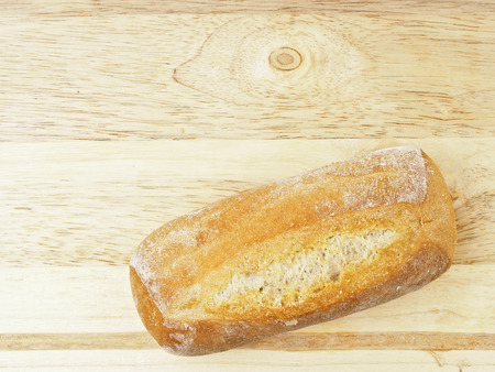deciduous mini french baguette bread on wood chopping with copy space