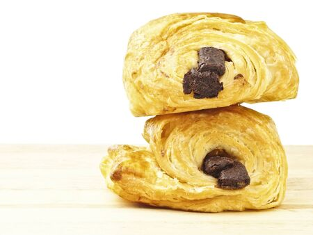 stack of two danish chocolate bread on wood floor in white background Stock Photo