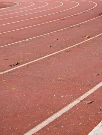 straight lanes of running track in sunlight photo
