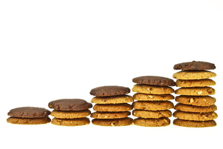 step of increase stack almond cookie with brown cookie on top  on white background photo