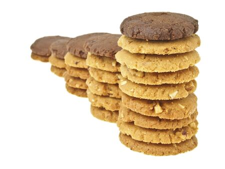 step increase of cookie stack bar with brown cookie on top on white background Stock Photo
