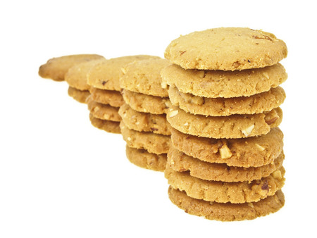 step increase of cookie stack bar on white background Stock Photo