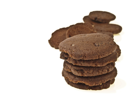 pile of delicious chocolate cookie with space on white background