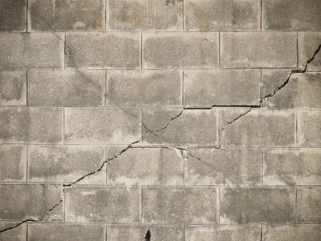 cross line fracture on brick wall with vignett corner Stock Photo