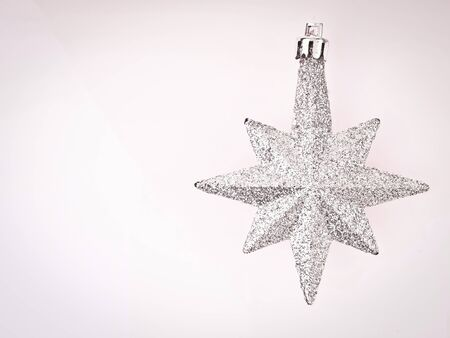 sliver: ornament sliver star on white background with vignett conner and copy space