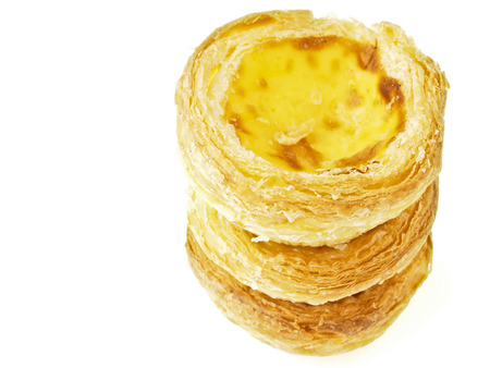 triple stack tower of delicious eggtart on white  Stock Photo