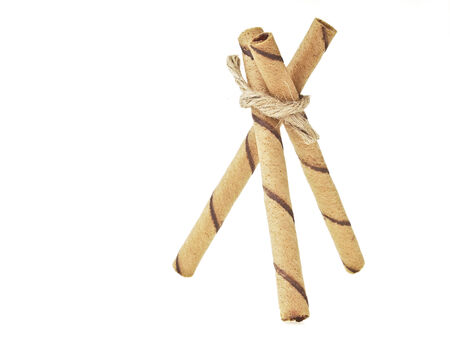 triangular wafer stick binding by hemp rope on white background photo
