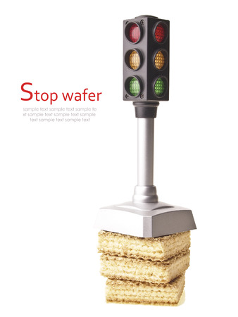 small model traffic light on wafer stack isolated on white background photo
