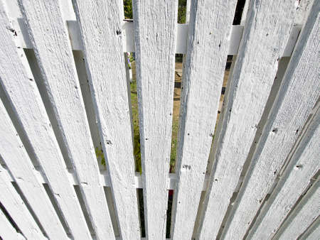 look down perspective of white wood palisade in sunny day
