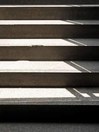 light and shadow on staircase in public area photo