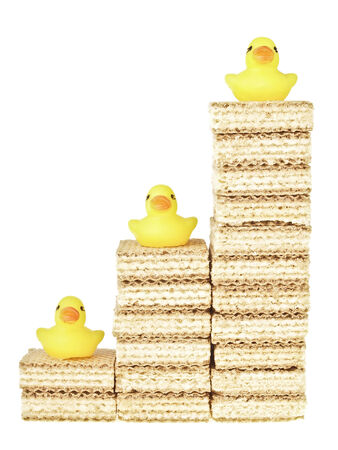 step of stack wafer increase with duck toy on top on white background