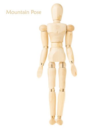 demonstration of wood manikin in mountain pose on white background. this pose is part of yoga training.