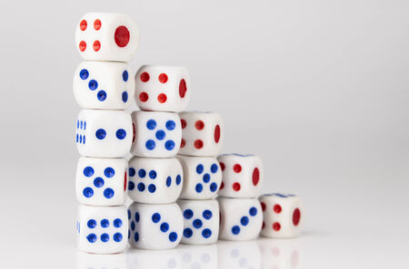 five step sequence stack of dice with number one point side on top Stock Photo
