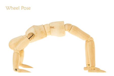 limber: demonstration of wood manikin in wheel pose on white background. this pose is part of yoga training.