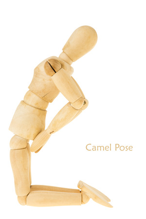 limber: demonstration of wood manikin in camel pose on white background. this pose is part of yoga training. Stock Photo