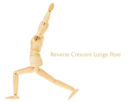 demonstration of wood manikin in reverse crescent lunge pose on white background. this pose is part of yoga training. photo