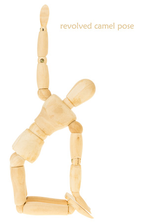 limber: demonstration of wood manikin in revolved camel pose on white background. this pose is part of yoga training. Stock Photo