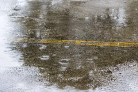 rain drops on street floor in daytime Stock Photo