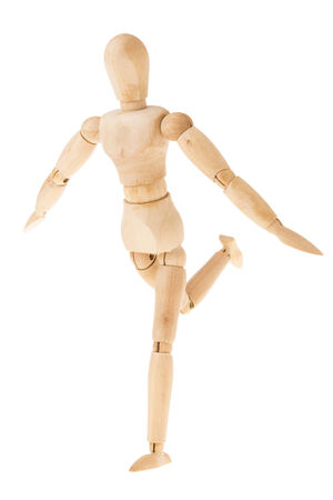 pose of wood figure in cheerful action on white background