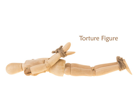 prone: pose of hand and leg of prone manikin is bind by hemp rope on white background prone Stock Photo