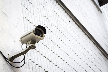 cctv camera for security at exterior of white building Imagens