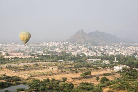 flying balloon travel over Pushkar city in mist scene,rajasthan, India Stock Photo