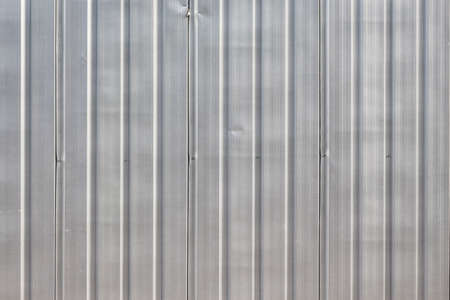 palisade: background of zinc corrugated fence at exterior in daylight Stock Photo