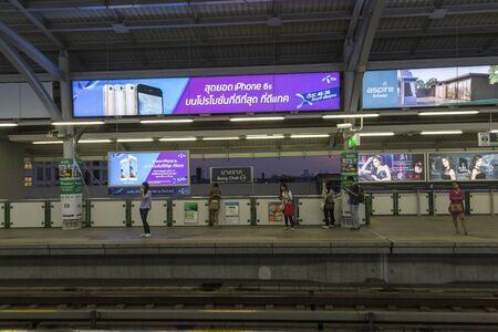 adboard: BANGKOK THAILAND - APR 8 : scene of unidentified people wait for skytrain in BTS Bang Chak station of bangkok on april, 8, 2016, thailand.