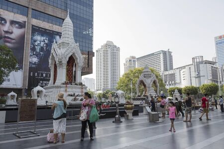 sacred trinity: BANGKOK, THAILAND - APR 17 : Unidentified people pray to Trimurati shrine at Central world in Ratchaprasong area on april 17, 2016. Thailand. Trimurati shrine is one of sacred item in Ratchaprasong area